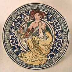 Alphonse Mucha, (1860-1939) |  Pottery Plate 1897. Earthware Diam 31. Signed and dated 97. Mark printed on reverse: Au Grand Dépôt, 21 Rue Drouot, Paris.