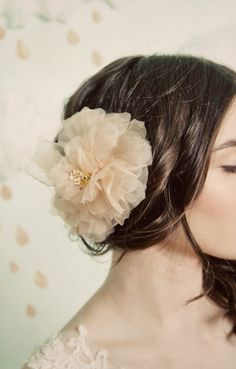 flower in the hair.....I wore one like this at my wedding.