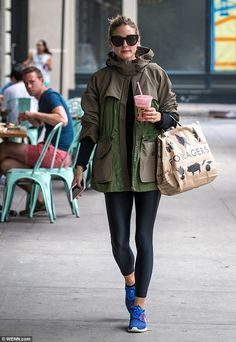 Cover up: On this occasion, Olivia chose to cover up her model-slim figure in leggings and a bulky army-green jacket