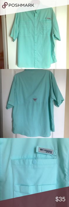 Columbia -Men's Short Sleeve Button Up Shirt Large Columbia - Teal Men's Short Sleeve Button Up Shirt in size Large for sale. In good condition! There is a little pilling on the back of the shirt and I took a picture of it. Also the inside of the neckline is a little worn. Please let me know if you have any questions! -Non-smoking home. Fast Shipping! Columbia Shirts Casual Button Down Shirts