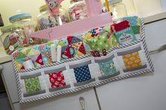Bee In My Bonnet: More Quilty Fun... Sewing machine cover that can be used under the machine for storing frequently used items. Nifty idea.