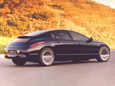 1995 Eagle Jazz concept.  In 1994, Eagle Jazz concept car was developed for the 1995 automobile show circuit. Eagle Jazz was a sporty sedan with a rounded hatchback tail. Built into that was a hatch-within-a-hatch, so a driver could easily open the rear end to store cargo. Car Pictures, Car Pics, Car Sketch, Concept Cars, Concept Auto, Automotive Design, Motor Car, Vintage Cars, Cool Cars