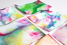 Science and Art for Kids: Marbled Milk Paper. Could do it on watercolour postcards and draw a design in black pen on top