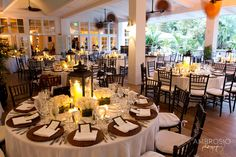 I like the center pieces with the lanterns, but maybe use smaller lanterns