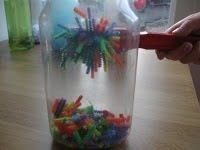 Great for toddler fine motor skills. Clean liter bottle etc. fill with pipe cleaner pieces about 1/2 inches long. Make sure to use different colors. Seal container, give child a magnet of some sort. The pipe cleaner pieces follow the magnet. Actually fun to watch.
