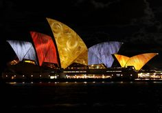"""""""Lighting The Sails"""" - Vivid Sydney turns Sydney's Opera House into a canvas for spectacular projections turning the shell-like rooftops into a slideshow of vibrant images, projecting everything from leopard-print patterns to hair."""