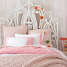 white rattan scroll headboard // girl's bedroom // currently 20% off #summersale