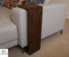 Simplistic in form and hand crafted to bring the natural character of the wood, using glued dovetail joints to secure the wood together, adding a beautiful yet elegant presence to your living room. The sofa armrest table is perfect for fitting over any sofa or arm chair, this will give a flat and stable surface for drinks, remote controls, laptops or tablets etc. It can also be used free standing. This product is made to order, and customised to suit the height of your armrest. When…