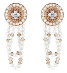 Louis Vuitton Voyage dans le temps Monogram Infini earrings.