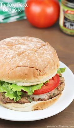 Turkey Pesto Burgers - moist burgers made with ground turkey, pesto, cilantro and green onions then topped with mozzarella and tomatoes. Cooked in 20 minutes!