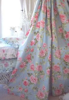 Lovely floral curtains in robin's egg blue and pink.---I should have an unabashedly girly bathroom while I can.
