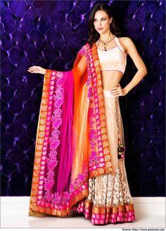 Halter Neck nude-coloured lehenga choli design with a shocking pink and orange bright #dupatta.  #LehengaCholi #CholiDesigns  #DesignerLehenga