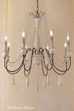 Farmhouse Lighting Design Tips Now is the perfect to start thinking about redecorating your farm home's interior. Wooden Chandelier, Coastal Chandelier, Farmhouse Chandelier, Beaded Chandelier, Farmhouse Lighting, Chandelier Pendant Lights, Chandelier Bedroom, Wood Pendant Light, Pendant Light Fixtures