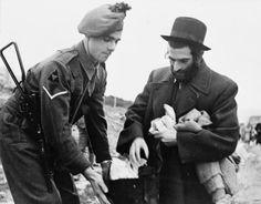 BRITISH FORCES MIDDLE EAST 1945-1947 (E 32164)   A Lance Corporal of the Irish Fusiliers checks the belongings of a Jewish civilian at a roadblock on the main Jaffa highway outside Jerusalem. Checks were carried out to identify members of the Jewish terrorist organisation Irgun Zyai Leumi, who had on 29 December 1946 kidnapped and flogged a British major and three staff sergeants.