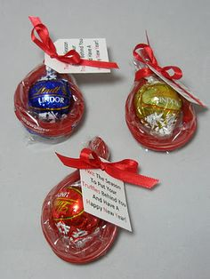 """a red Twizzler is wrapped around a Lindt truffle and and note is attached: """"Twiz the season to put your Truffles behind you and have a Happy New Year!"""""""