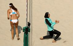 Doaa Elghobashy of Egypt celebrates during a Beach Volleyball match against Marta Menegatti and Viktoria Orsi Toth of Italy. Ezra Shaw/Getty Images