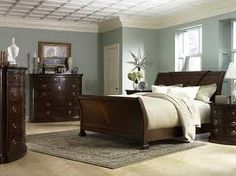 Love the color of the walls with the dark wood furniture. This would definitely work with our bedroom set
