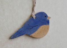 Bluebird Ornament Stoneware Made In Maine by by ConceptsInClay, $5.00 This seller has many more adorable ornaments, including more birds! The quality is fantastic--I own 2 of their ornaments already and plan to purchase more in the future!