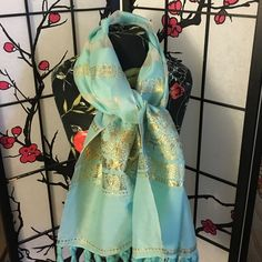 """Mint color shawl with gold threading Like new mint colored with gold colored shawl.  Very versatile and can be worn different ways.  Not sure what fabric this is.  Flower design.  Approx measurements are 40"""" wide about 62"""" in length. Accessories Scarves & Wraps"""