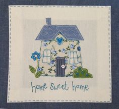 Appliqué cushion by The Apple Cottage Company. Totally adorable!! Love it! LOVE the colors!