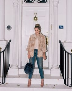 Julia Engel shares her daily look on Gal Meets Glam. Julia is wearing a Tyler Boe jacket, Cuyana top, Citizens of Humanity jeans, and more. Click to shop!