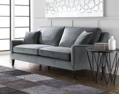 HANOVER SOFA   Graceful contoured track arms give this sofa an elegant but contemporary look. Foam seat and fibre filled back cushions make it exceptionally comfortable. Stocked in a beige cotton-linen fabric and granite fabric with a kiln dried solid wood frame. (toss cushions not included)