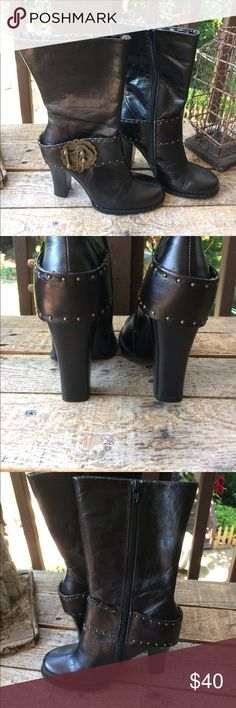 Black leather boots with metal accents size 7. Black leather boots with metal accents and very pretty lining. Zips on inside. Four inch heel. Like new condition. Size 7.  Seller can't wear heels. 😘 Shoes Heeled Boots