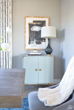 Minted art Hovering Union by Misty Hughes transitional style dining room mindful gray paint aqua and brass bar cabinet kravet raid drapes in silver-1