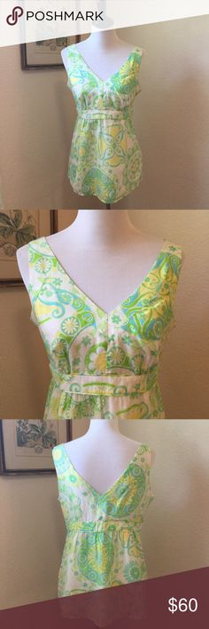 LILLY PULITZER Cotton Silk Sleeveless Blouse Gorgeous blue, yellow and green sleeveless blouse in signature Lilly paisley print. Shell is cotton silk blend and lining is 100% silk. Lightweight and perfect for summer. Empire waistline. Side zipper. Excellent like new condition. Lilly Pulitzer Tops Blouses