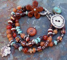 Bracelet Southwest Knotted -- Orange Carnelian and Turquoise Lampwork and Silver with Flowers. $90.00, via Etsy.