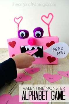 Make learning about letters fun for preschoolers with this Valentine Monster Alphabet Game. Kids will smile and giggle as they feed the monster letters. Make sure to make some chomping monster chewing sounds to make the activity extra fun. Kinder Valentines, Valentine Day Boxes, Valentine Theme, Valentines Day Party, Valentine Decorations, Valentines Sweets, Saint Valentine, Valentine's Day Crafts For Kids, Valentine Crafts For Kids