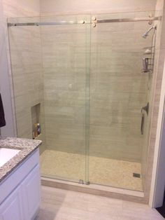 Frameless Serenity Series with sliding panel door and fixed panel