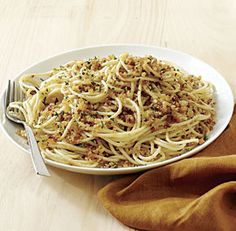 Spaghetti with Fresh Breadcrumbs, Garlic, and Extra-Virgin Olive Oil - This is a twist on spaghetti aglio e olio, a traditional Italian pasta dish featuring garlic, olive oil, and chile. The fresh breadcrumbs soak up the spicy oil and garlic in a most delicious way.