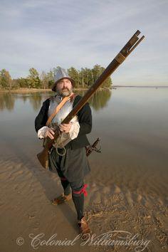 17th Century soldier exploring along the James River near Jamestown. Virginia circa 1607.