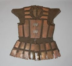 Coat of armour made of bronze and turtle-shell plates, linked with chain.