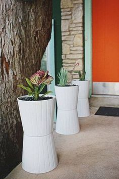 Glue two flower pots together to make one tall one. Great for the entry to the house.
