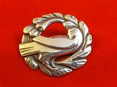 SoVintageous is offering this beautiful vintage Coro Norseland sterling silver Dove brooch based on Danish designer Georg Jensen's design.  Made in the early 1940s this highly collectible brooch is in