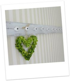 vintage cabinet pulls & rustic board into charming peg board...