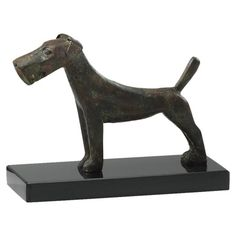 Set of two Scottish dog figurines crafted of iron and granite.   Product: Set of 2 dog figurinesConstruction Material...