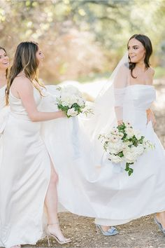 This bride was elegantly dressed in a Monique Lhuillier wedding gown with french blue Valentino heels. Alongside her, the bridesmaids wore complimenting white gowns paired with soft bouquets of fresh garden roses grown from local farms. See the rest of this romantic fall wedding unfold on stylemepretty.com! Photography: @bryanmillerphoto  #weddingdress #moniquelhuillier #whitegown #bridesmaids #somethingblue