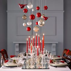 Ornament chandelier above a glowing holiday table