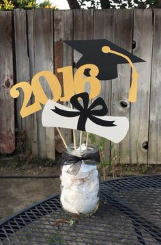 What a fabulous way to accent your Graduates big day! This charming Graduation Centerpiece is the perfect addition to your Graduation Partys table decor. Graduation Centerpiece includes: -Graduation Cap -Diploma -2017 All are placed on different length wood picks, so that they can be arranged to show off each of their individual charm.  **If you need more than 6 please send me a message and I would be happy to set up a custom listing for you :)  **Mason Jar and Paper Shred are not included…