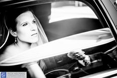 www.rickhelmanphoto.com  Bride pulling up to church in limo, New York