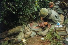 23 Feb 1968, Hue, South Vietnam. Wounded U.S. Marine Being Treated by Medic. Image © Bettmann/CORBIS
