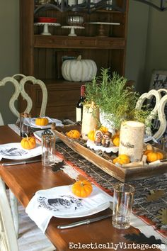 Beautiful Thanksgiving table - love the dough bowl centerpiece, twig runner layered over an orange striped runner from HomeGoods and fun dish towel napkins! eclecticallyvintage.com sponsored pin