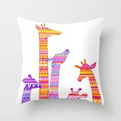 Giraffe Silhouettes in Colorful Tribal Print Throw Pillow by Annya Kai on Wanelo