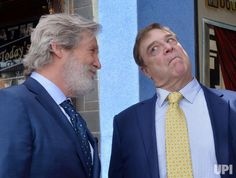 Actor John Goodman (R) shares a laugh with actor Jeff Bridges during an unveiling ceremony honoring Goodman with the 2,064th star on the…