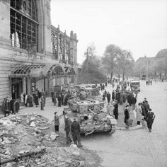 A Cromwell tank and Challenger tank of 8th Kings Royal Irish Hussars, 7th Armoured Division, surrounded by German civilians outside Dammtor railway station in Hamburg, Germany 5 May 1945