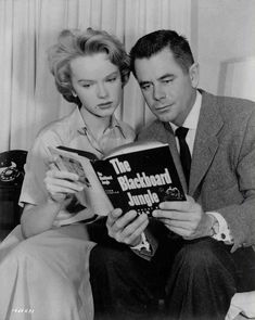 """Anne Francis and Glenn Ford brushing up on the source material for BLACKBOARD JUNGLE April 1954 - Bill Haley and the Comets, record """"Rock Around the Clock"""" Glen Ford, Anne Francis, Turner Classic Movies, Hollywood Stars, Hollywood Actor, Old Movies, Vintage Hollywood, American Actors, The Book"""