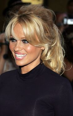 Pamela Anderson, 46, is a longtime #fitness fanatic who follows a #vegan diet and strength-trained to maintain her age-defying physique